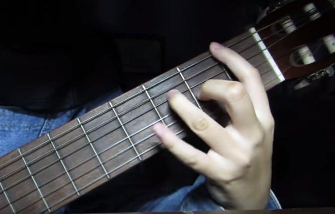 Playing Classical Guitar (Erika)